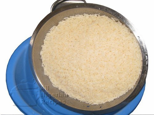 parboiled rice in a sieve